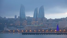 January misty twilight in Baku. View on the flame towers timelapse stock footage
