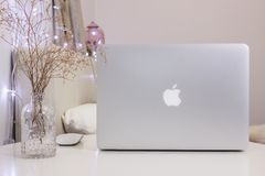 1 of January, Moscow. Cozy room workplace with Macbook Pro, Mockup. Trendy feminine desktop, blog social post. Photography Royalty Free Stock Photos