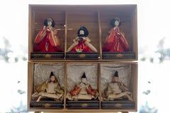 Vintage Japanese ceramic doll on dark background stock images