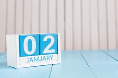 January 2nd. Day 2 of month, calendar on wooden background. Winter time. Empty space for text.  Royalty Free Stock Photos