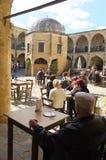 People drinking in caffe in the Big Inn Buyuk Han of Nicosia. 30 january 2014-nicosia -cypros -people drinking in caffe in the Big Inn Buyuk Han of Nicosia Royalty Free Stock Images