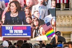 January 27, 2019 Oakland / CA / USA - American and rainbow flags raised at the Kamala Harris for President Campaign Launch Rally royalty free stock photos
