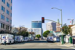 January 27, 2019 Oakland / CA / USA - Landscape in downtown Oakland, east San Francisco bay area; USPS vehicles parked on both. Sides of the road stock image