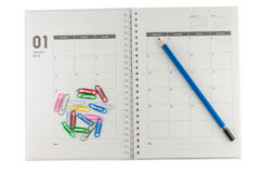 2014 January organizer with pencil & clips. 2014 January organizer with pencil & clips, concept for business planing Royalty Free Stock Photos