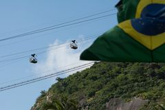 Sugar loaf cable car and brazilian flag stock photo