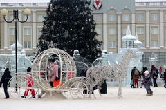 January 4, 2019. Russia, Izhevsk. City square on new year`s day, sculpture of horses and Christmas tree stock photos