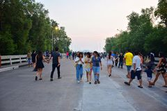 3 girls walking together fun on the bridge. January 21, 2018 - Samut Prakan, Thailand, 3 girlfriends walk around on the corridor in the middle of the road Royalty Free Stock Images
