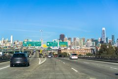 January 20, 2018 San Francisco / CA / USA - Driving on the freeway towards downtown San Francisco; the financial district skyline. In the background stock image