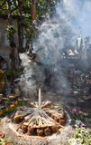 Shaman ceremony fire. January 31, 2015 San Pedro la Laguna, Guatemala: Mayan man engulfed in smoke during a shamanic ritual Stock Photography