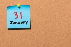 January 31st. Day 31 of month, Calendar on cork notice board. New year at work concept. Winter time. Empty space for Stock Photos