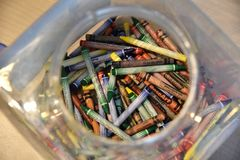 January 2019, Tampa, FL - A plastic box filled with colorful crayons royalty free stock images
