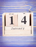 January 14th. Date of 14 January on wooden cube calendar. Purple board as background royalty free stock images