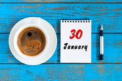 January 30th. Day 30 of month, calendar on blue wooden office workplace background. Winter at work concept Royalty Free Stock Image