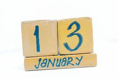January 13th. Day 13 of month, calendar on wooden background. Winter time, year concept. January 13th. Day 13 of month, handmade cube wooden calendar. Winter royalty free stock image