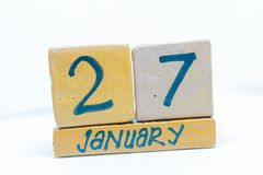 January 27th. Day 27 of month, calendar on wooden background. Winter time, year concept. January 27th. Day 27 of month, handmade cube wooden calendar. Winter royalty free stock image