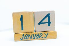 January 14th. Day 14 of month, calendar on wooden background. Winter time, year concept. January 14th. Day 14 of month, handmade cube wooden calendar. Winter stock image
