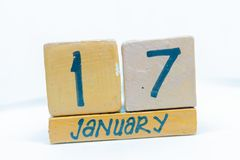 January 17th. Day 17 of month, calendar on wooden background. Winter time, year concept. January 17th. Day 17 of month, handmade cube wooden calendar. Winter royalty free stock photo