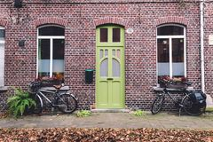 Street, Wall and Bikes in autumn Ghent stock photos