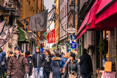 January 21, 2017: Tourists by the Aifur restaurant in the old to Royalty Free Stock Photography