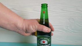 January 26, 2018 Ukraine Kiev  beer Heineken. January 26, 2018 Ukraine Kiev beer Heineken hand opens stock footage