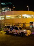 Ambulance parked next to building, vertical, Bangkok, Thailand. January 2, 2018. Wide angle detail of a Emergency Medical Services ambulance parked next to a stock image