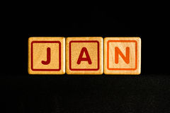 January on wood Cubic on black background Royalty Free Stock Image