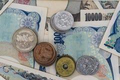 Japón 1000 billete de banco 5000 10000 y moneda Imagen de archivo libre de regalías