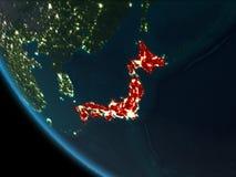 Japón en la noche de la órbita ilustración del vector
