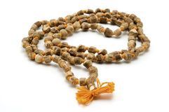 Japa Mala. (set of beads commonly used by Hindus and Buddhists) on a white background Stock Images
