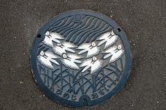 Japan's在边路的人孔盖的秀丽自然样式 免版税库存照片