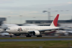 Japan Airlines Boeing 777 on runway. Japan Airlines Boeing 777 in motion on the runway Stock Images