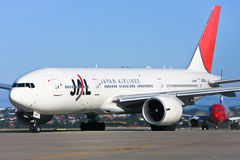 Japan Airlines jet airliner on runway Stock Photo