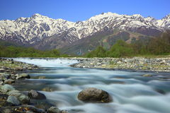 Japan Alps and river. Mt. Goryudake and Matsukawa River in Hakuba Village, Nagano, Japan Royalty Free Stock Image