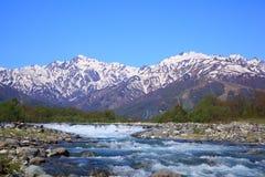 Japan Alps and river. Mt. Goryudake and Matsukawa River in Hakuba Village, Nagano, Japan Stock Images