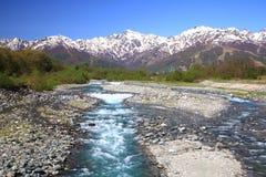 Japan Alps and river. Mt. Goryudake and Matsukawa River in Hakuba Village, Nagano, Japan Royalty Free Stock Photo