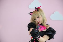 Japan anime cosplay , portrait of girl cosplay in pink room background. Japan anime cosplay , portrait of girl cosplay in pink room royalty free stock images