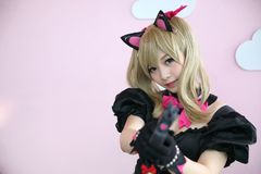 Japan anime cosplay , portrait of girl cosplay in pink room background stock image