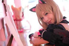 Japan anime cosplay , portrait of girl cosplay in pink room background royalty free stock photography