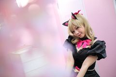 Japan anime cosplay , portrait of girl cosplay in pink room background stock photo