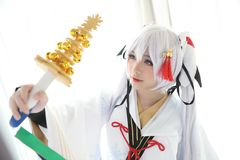 Japan anime cosplay , white japanese miko in white tone room. Japan anime cosplay , white japanese miko in white room royalty free stock photography