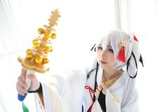 Japan anime cosplay , white japanese miko in white tone room. Japan anime cosplay , white japanese miko in white room stock photography