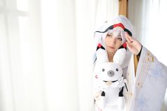 Japan anime cosplay , white japanese miko in white tone room. Japan anime cosplay , white japanese miko in white room royalty free stock images