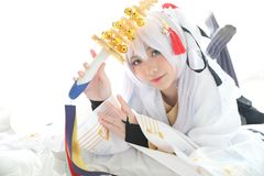 Japan anime cosplay , white japanese miko in white tone room. Japan anime cosplay , white japanese miko in white room stock photos