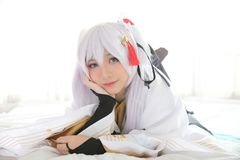 Japan anime cosplay , white japanese miko in white tone room. Japan anime cosplay , white japanese miko in white room royalty free stock photo