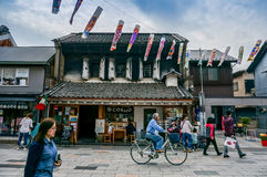 JAPAN - April 6, 2015: People walk and cycling in old city of Ka Royalty Free Stock Image