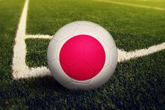 Japan ball on corner kick position, soccer field background. National football theme on green grass stock images