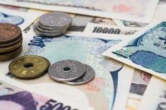 Japan 1000 Banknote 5000 10000 und Münze Stockbild