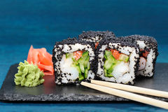 Japan black tobiko rolls with cream cheese and cucumber served w Stock Photo