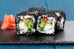 Japan black tobiko rolls with cream cheese and cucumber served w Royalty Free Stock Photography