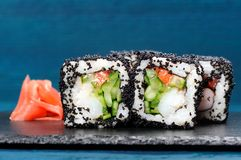 Japan black tobiko rolls with cream cheese and cucumber served w Stock Photography
